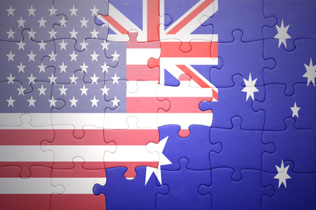 puzzle with the national flag of united states of america and australia.concept
