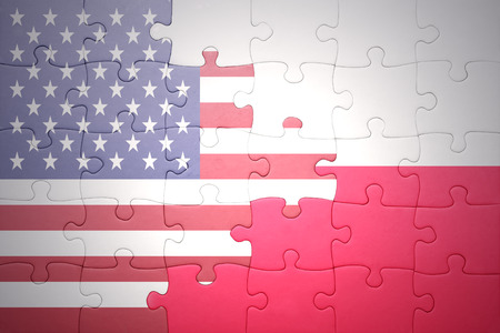 banderas americanas: puzzle with the national flag of united states of america and poland.concept