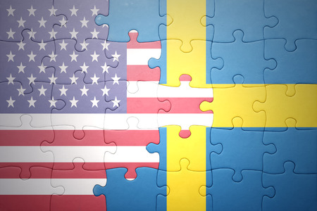 banderas americanas: puzzle with the national flag of united states of america and sweden.concept