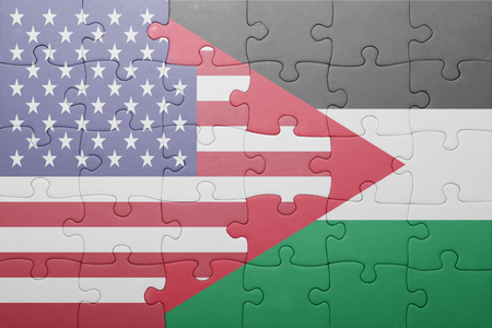 puzzle with the national flag of united states of america and palestine.concept