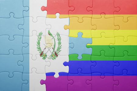 bandera gay: puzzle con la bandera nacional de Guatemala y la bandera gay. Foto de archivo