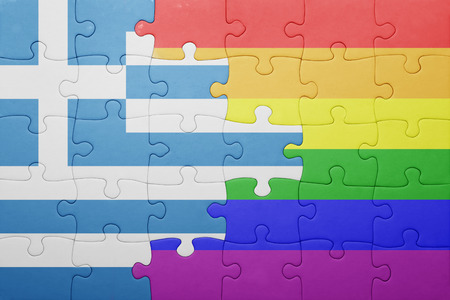 homosexual partners: puzzle with the national flag of greece and gay flag.