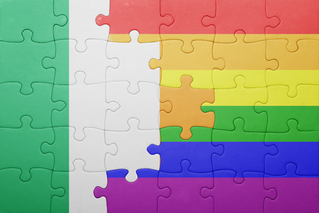 homosexual partners: puzzle with the national flag of ireland and gay flag.