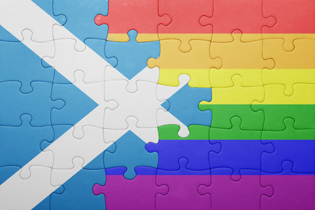 homosexual partners: puzzle with the national flag of scotland and gay flag.