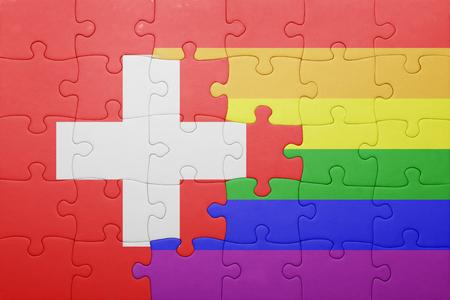 bandera gay: puzzle con la bandera nacional de Suiza y bandera gay. Foto de archivo