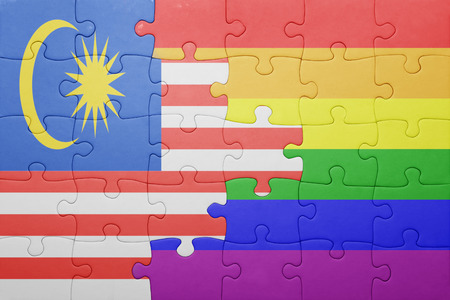 bandera gay: puzzle with the national flag of malaysia and gay flag. Foto de archivo