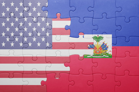 port au prince: puzzle with the national flag of united states of america and haiti .concept Stock Photo
