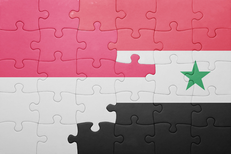 middle east conflict: puzzle with the national flag of syria and indonesia