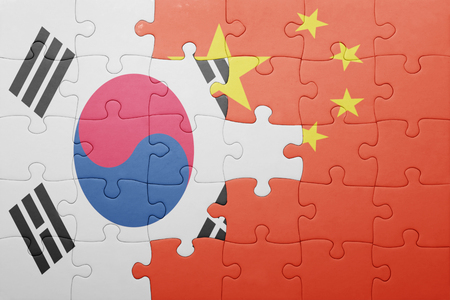 south korea flag: puzzle with the national flag of china and south korea