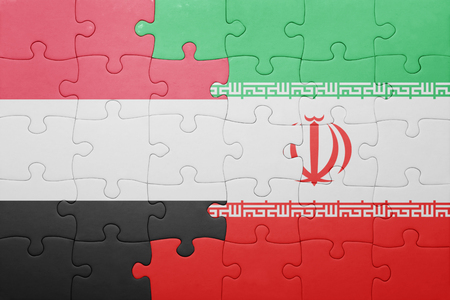 iran: puzzle with the national flag of iran and yemen . concept