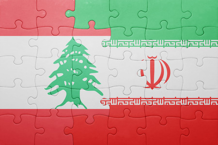 iran: puzzle with the national flag of iran and lebanon . concept