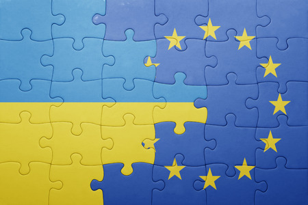 european: puzzle with the national flag of ukraine and european union