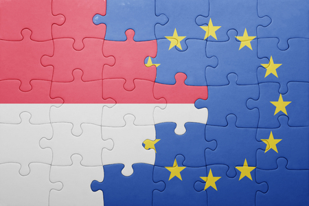 puzzle with the national flag of indonesia and european union . concept Stock Photo