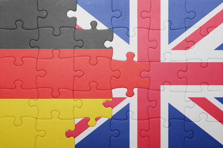 puzzle with the national flag of great britain and germany . concept