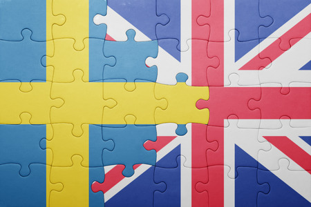 puzzle with the national flag of great britain and sweden . concept