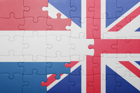 puzzle with the national flag of great britain and netherlands . concept