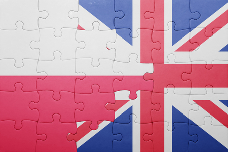 puzzle with the national flag of great britain and poland . concept Stok Fotoğraf