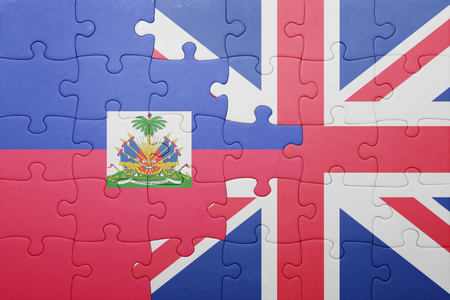 port au prince: puzzle with the national flag of great britain and haiti . concept