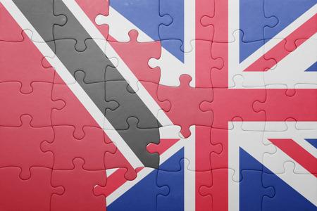 national flag trinidad and tobago: puzzle with the national flag of great britain and trinidad and tobago . concept