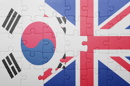agression: puzzle with the national flag of great britain and south korea . concept Stock Photo