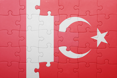 lima region: puzzle with the national flag of turkey and peru . concept