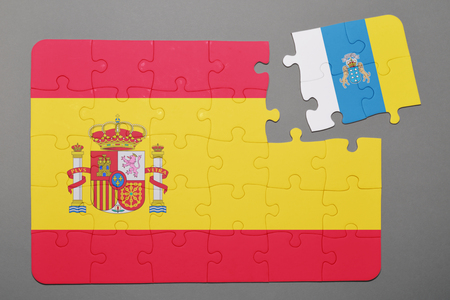 detach: Puzzle with national flag of Spain and canary islands piece detached. Concept Stock Photo