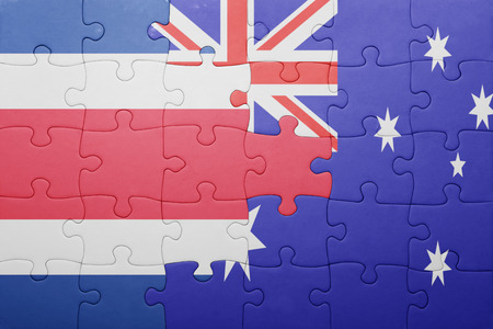 costa rican flag: puzzle with the national flag of costa rica and  australia. concept