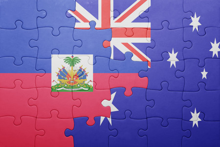 port au prince: puzzle with the national flag of haiti and  australia. concept Stock Photo