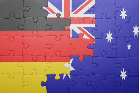 germany flag: puzzle with the national flag of germany and australia. concept