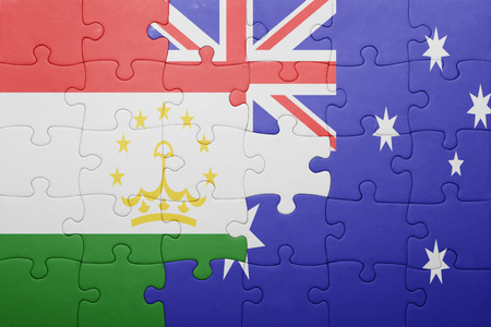 economy of tajikistan: puzzle with the national flag of tajikistan and australia. concept