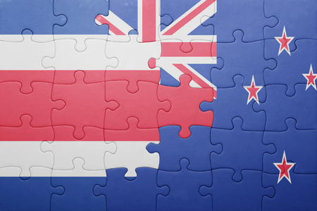 costa rican flag: puzzle with the national flag of costa rica and new zealand. concept