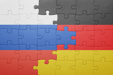 puzzle with the national flag of russia and germany . concept