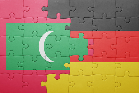 german north sea region: puzzle with the national flag of germany and maldives. concept