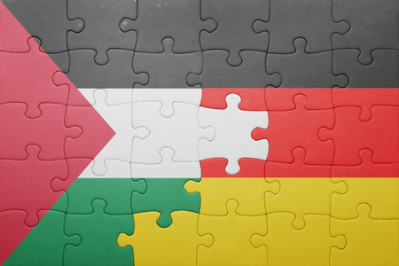 palestine: puzzle with the national flag of germany and palestine. concept Stock Photo