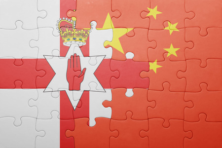 northern ireland: puzzle with the national flag of northern ireland and china. concept