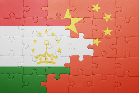 economy of tajikistan: puzzle with the national flag of tajikistan and china. concept Stock Photo