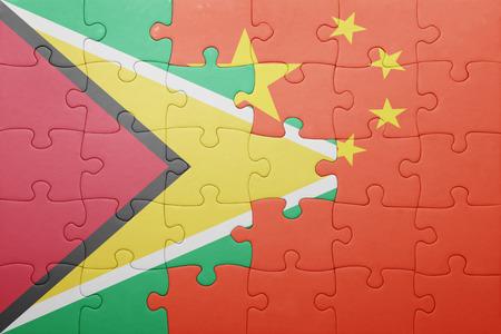 banderas america: puzzle con la bandera nacional de Guyana y China. concepto