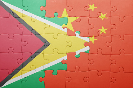 american flags: puzzle with the national flag of guyana and china. concept