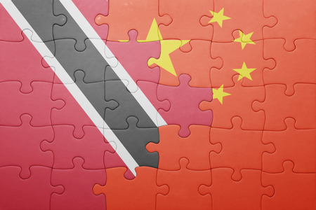 national flag trinidad and tobago: puzzle with the national flag of trinidad and tobago and china. concept Stock Photo