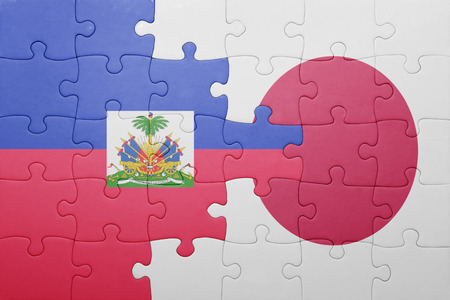 port au prince: puzzle with the national flag of haiti and japan. concept