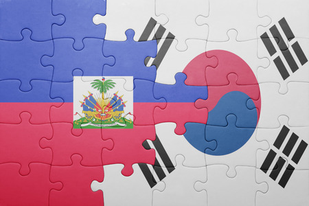 port au prince: puzzle with the national flag of haiti and south korea . concept