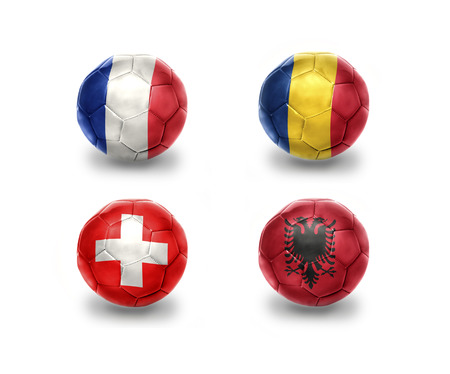 nice france: euro group A . realistic football balls with national flags of france, romania, switzerland, albania Stock Photo