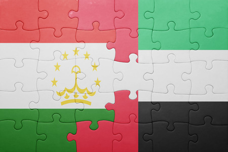 economy of tajikistan: puzzle with the national flag of united arab emirates and tajikistan . concept
