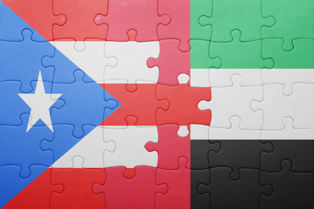 bandera de puerto rico: puzzle with the national flag of united arab emirates and puerto rico . concept