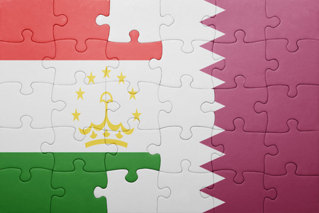 economy of tajikistan: puzzle with the national flag of tajikistan and qatar . concept Stock Photo