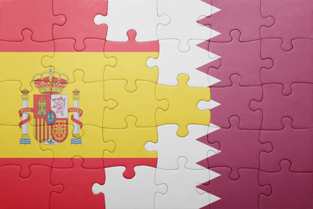 puzzle with the national flag of spain and qatar . concept Stock Photo