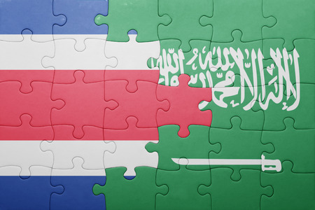 costa rican flag: puzzle with the national flag of saudi arabia and costa rica . concept