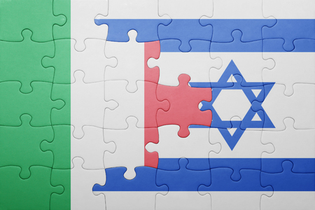 puzzle with the national flag of israel and italy . concept