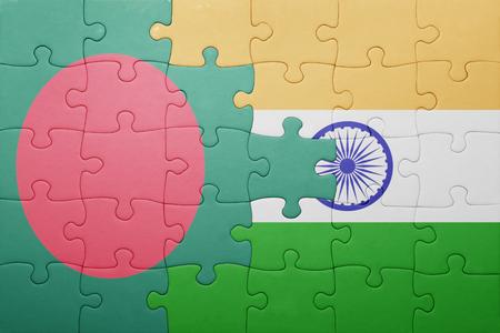 national flag bangladesh: puzzle with the national flag of bangladesh and india. cotncept