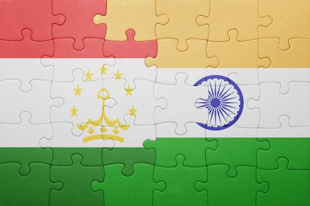 economy of tajikistan: puzzle with the national flag of tajikistan and india. cotncept Stock Photo
